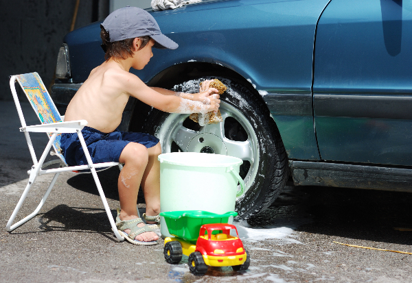Little Kid Cleaning car